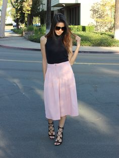 Tailored and subtly pleated, pink culottes are as appropriate for the office as they are for a day of shopping on the promenade. Tuck a white blouse into them o