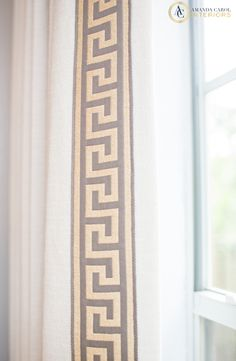 Greek key trim on solid curtains...it's all in the details