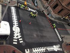 The City of Baltimore, Maryland installs artistic crosswalks (December 2013) as part of an effort to increase the amount of art in public spaces - Artist Paul Bertholet created a crosswalk which looks like a giant zipper opening.