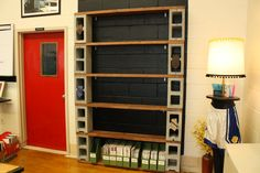 D.I.Y. cinder block shelves for displaying student work (or great for books, magazines, etc). Less expensive approach to gaining a large shelf unit!