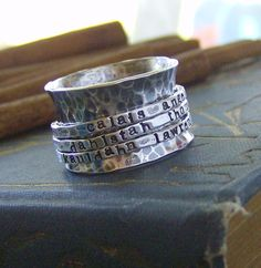 A fun and unique way to show off whats in your heart! My wide 1/2in band sterling silver ring is hammered for a beautiful rustic glimmer. 3 yes 3 o...