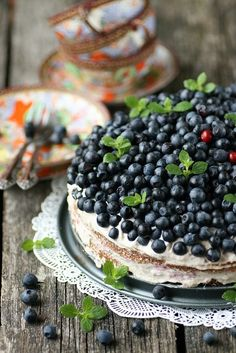 Pretty picture of fresh blueberries, topping a perfect cheesecake