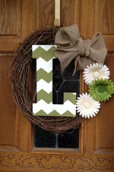 I love wreaths with initials. this is cute, and it looks very DIY friendly...like even I can do it. Lol.