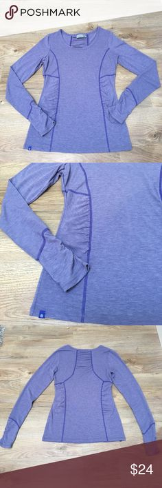 Athleta long sleeve, ruched workout top, XS Lavender/purple long sleeve from Athleta. In amazing condition. Ruched sleeves and front/back makes it extremely flattering. 63% polyester 33% rayon 7% spandex Athleta Tops Tees - Long Sleeve
