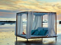 I'm in love.  Can I spend some quiet time with a book and a bottle of vino here?!?  Antigua canopied daybed from Frontgate.com.