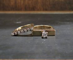 This wedding set is SOOOO COOL! Everyone at the store points it out but of course there is a caveat--it is tiny. At just a size 4 for both the engagement ring and the band, this set is looking for a dainty ring finger (or pinky finger!). This is a true Cinderellas slipper. A four prong-set .20ct Round Brilliant cut diamond with G-H Color and SI1 Clarity rises above a flat-sided geometric setting in 14k. The wedding band contains seven Round Brilliant cut diamonds weighing approximately…