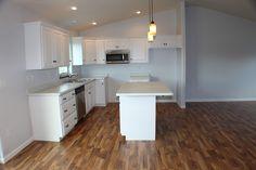 (BV4) Custom Pecan Floor Plan Kitchen. Square Raised Painted Cabinets. White Carrara Countertops. Italian Walnut Laminate Flooring.