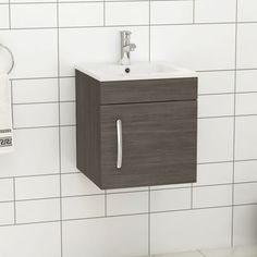 Grey Elm cabinet unit is manufactured with Moisture-resistant MFC with Gloss White ceramic sink. It features a smooth soft close door and chrome handle, that will add more value to this compact vanity unit. Check now! ............................................................................................................................................#VanityUnit #BathroomDesign #WallHungVanitySinkUnit