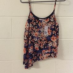 Tank Brand new! Tag still on! Flower tank with adjustable straps. Bottom cut is high to low. Forever 21 Tops Tank Tops