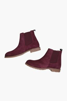 A leather chelsea ankle boot with no slip sole and elasticated panel. In…