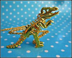 dinosuar skeleton necklace by alapopjewelry--just different!