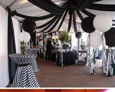 love the cocktail table..... Fun receptions with fabric ceilings. Black and white, wedding, reception, event decor, ceiling decor, stripes. http://www.partyplannerdenver.com