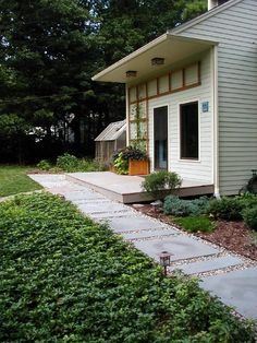 Love the gravel path with metal edging and concrete pavers.