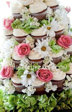 Wedding @Fontanna Leone I think cupcake towers are adorable and probably a little cheaper!! But seriously how cute is that? And especially with all the kiddos that would be there!!!