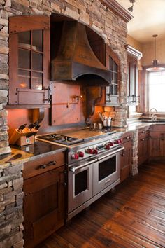 This is perfect...the mix of wood and stone. And the Mission style cabinets.