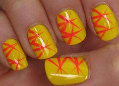 Uñas amarillas con destellos naranjas en forma de estrella de mar. Busca diseños como éste en http://www.1001consejos.com/belleza