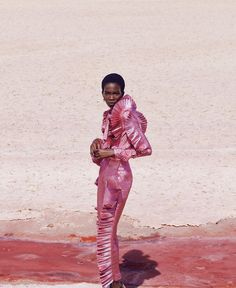 The beautiful Aamito Lagum is shot for the Harper's Bazaar December issue by Daniel Riera in the mesmerizing ambience of those Spanish pink salt fields.