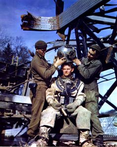 American diver Michael O'Brien (center) is helped into his dive suit by Albert Boettner (left) and E.L. Kennedy, all from the 1058 Port Construction Company, near Aachen (or Aix-la-Chapelle), Germany, March 1945. The men were engaged in repairing a railroad bridge destroyed by the French resistance fighters to hamper the German retreat from France. (Photo by PhotoQuest/Getty Images)