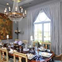 """""""The dining room features a large fan-topped window draped in silk. Julie Neill designed the chandelier.""""   with www.parisfinds.com http://www.myneworleans.com/Louisiana-Life/November-December-2013/Home-Made-in-Louisiana/"""