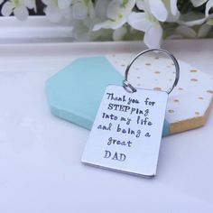 A personal favourite from my Etsy shop https://www.etsy.com/listing/279535624/step-dad-key-ring-step-dad-gift-fathers