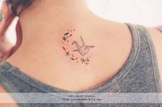 I love this tattoo made by Seul. This designer creates tattoos with cheerful and amazing small colours and details. Origami tattoo with a half arch made of flowers and little figures. Seoeon Tattoo, Diskrete Tattoos, Kunst Tattoos, Music Tattoos, Cute Tattoos, Beautiful Tattoos, Body Art Tattoos, Tatoos, Origami Tattoo