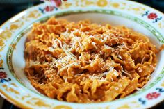 Pasta a la Vodka via the Pioneer Woman...I LOVE this recipe!! I always add in fresh chopped tomatoes with the tomato puree, and fresh basil at the end. Yum.