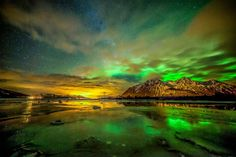 Green Aurora Above Sortland, Norway Photo Credit: (Benny Høynes)The photographer deserves credit so DO NOT remove credit information. Thank you.