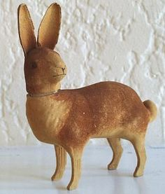 An anatomically strange flocked rabbit candy container