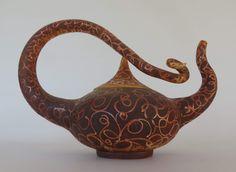 Colleen Lehmkuhl - Teapot. Raku, fumed with ferric chloride.