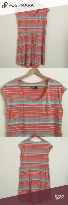 """The North Face Medium Shift Midi Activewear Dress Comfortable casual active wear dress from The North Face in size Medium.  Dress feature short sleeves, round scoop neck, matching fabric string tie, and cap sleeves.  Color is tangerine and aqua green stripes.  Dimensions include: 21"""" across shoulders, 38"""" bust, 36"""" waist, 38"""" hips, and length from shoulder to bottom hem 35"""" North Face Dresses Midi"""