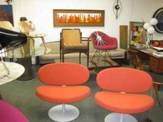Cappelini Sun Lounge Chairs Pair/ Orange / Heavy /Original / Mint Condition ...Red Padded Eames Rocking Chair ... Arne Vodder Lounge Chair / All original / Excellent condition ... Italian desk and Chair atributed to Gio ponti/ Great Shape / From The Estate of Famed Screenwriter Daniel Teradash/W Providence ... Nelson Eye Clock ... Amazing Danish Enamel on Copper Art / Walnut Framed ...much more. Vintage mid century