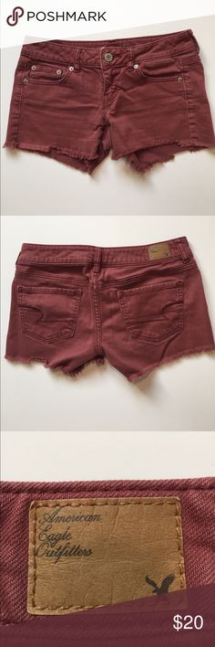 American Eagle Outfitters Maroon Denim Shorts Raw hem, maroon shorts. Fabric has stretch to it. Zip fly. Approximate measurements... Waist across 15 inches. Inseam 3 inches. Length 9.5 inches. Great for fall! American Eagle Outfitters Shorts