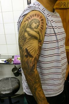 Full Sleeve Tattoo Designs are now more popular than ever. Check out our list of 25 Full Sleeve Tattoo Designs at Design Press now! Angel Sleeve Tattoo, Angel Tattoo Men, Tattoo Sleeves, Arm Tattoo, Tattoo Foto, Tatoo Art, Tattoo Life, Full Sleeve Tattoo Design, Full Sleeve Tattoos