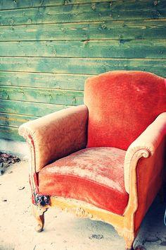 Red velvet chair, blue green wall tattered velvet nestprettythings:    Armchair by Jeanette Seflin on Flickr.