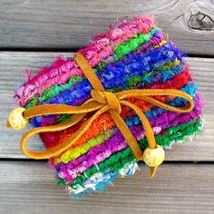 """9 ¼"""" x 4 ½"""" - Design by Theresa PulidoMade with Sari Ribbon Strips, batik fabric lining, suede strips, wood beads."""