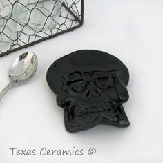 Dress up your Halloween tea party with this personal size black ceramic skeleton skull tea bag holder or spoon rest.  This black skull is both decorative and functional, not only does it make a great