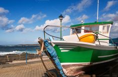 Check out Old fishing boat, Lanzarote island by JCB Photogr@phic on Creative Market