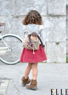 love her curly hair and the boots. << this will soooo be my kid! =]