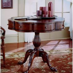Butler Specialty Company Plantation Cherry Clover Pedestal Table from Bellacor