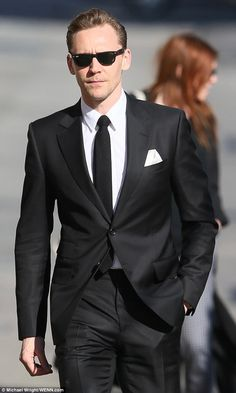 Tom Hiddleston channels Resevoir Dogs in a sharp suit and shades as he makes Jimmy Kimmel appearance. Link: http://www.dailymail.co.uk/tvshowbiz/article-4299786/Tom-Hiddleston-sports-stubble-Ray-Bans-Hollywood.html