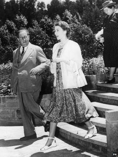 The Queen walks through the Sagana lodge in Kenya alongside Sir Philip Mitchell, Governor of Kenya, a few hours after receiving the news her father had died February 1952