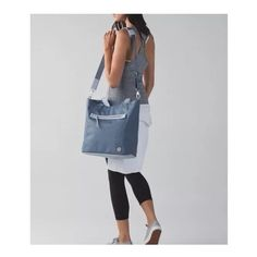 """🔆 Lululemon Out & About Tote Handbag New with tags. Color blue denim. Crossbody Shoukder bag Tote and Clutch. Fabric is durable with an easy to wipe clean base. Padded pocket fits a 15"""" laptop. Wet/dry pocket for sweaty gear. Tested to hold 50lb. 14.5 x 13.5 x 8. ✨Save $$$ when bundling with other items. 📍NO TRADE lululemon athletica Bags Totes"""
