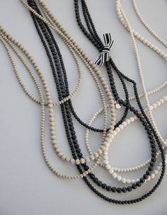 The three-part Kolmen kerho necklace is poetically delicate. The pearls can be worn with or without the ribbon, as best fits the occasion. Wooden Jewelry, Handmade Jewelry, Pearl Necklace, Beaded Necklace, Wooden Shapes, Anklet, Hair Pieces, Bracelets, Necklaces