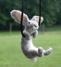 Felted swinging rabbit necklace by Motley Mutton.