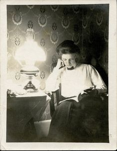 Woman Reading by Lamplight by depthandtime, via Flickr