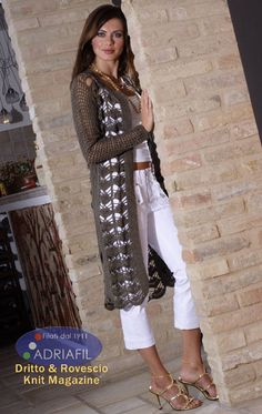 Nice long vest free pattern from Tricotin..com (in French)