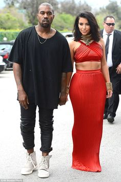 Hand in hand: Kanye West arrives with Kim Kardashian at the RocNation Pre Grammy Brunch on Saturday in Beverly Hills