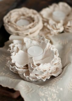 http://www.thisheartofmineblog.com/2013/09/07/diy-with-design-mom-plaster-flower-votives/