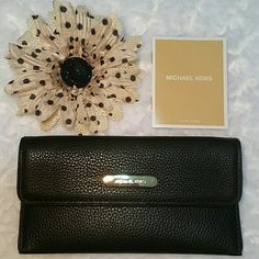 ⬇Spring Sale⬇Michael Kors Austin Wallet Black Austin Flat Continental leather wallet. Brand new, no knicks in zipper, no scuffs on leather. Has care card inside, shown in fourth picture. Beautiful, compact wallet! Has money slot, and 4 credit card slots, with change pocket on back side. Small knicks on hardware, please see second post for additional picture. Hard to see, but in the right lighting you can tell they're there. Reasonable offers are welcome! Michael Kors Bags Wallets