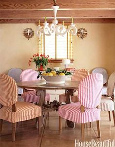 Slipcover chairs. Use same pattern in different color on each chair.